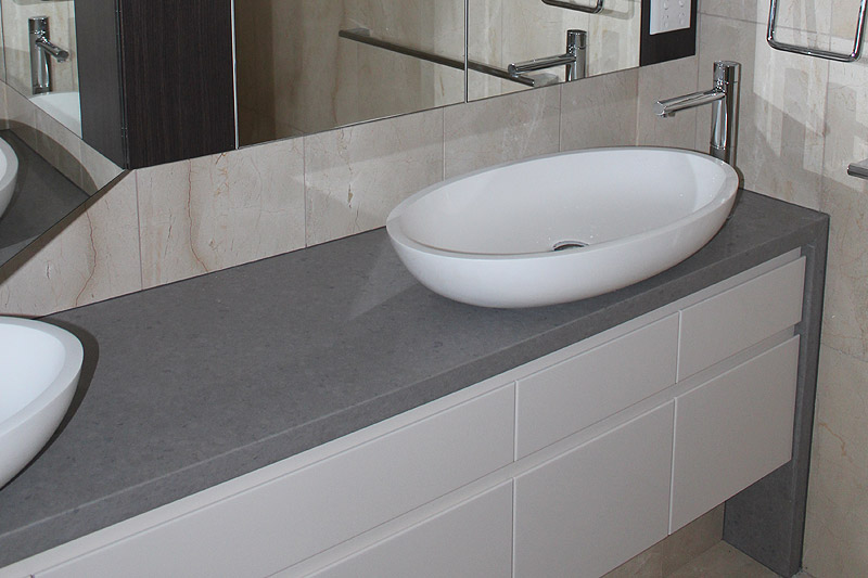 Vanity bench top with stone waterfall edges